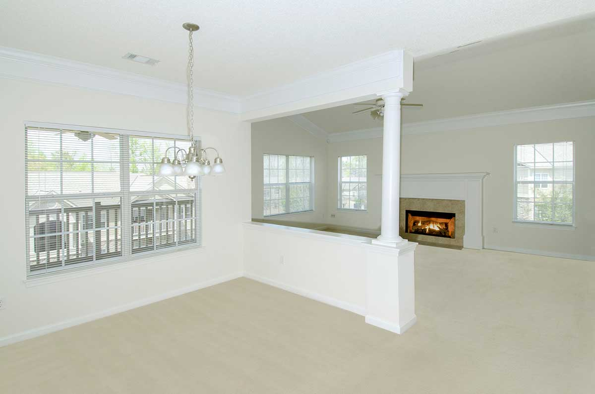 Greystone Fall Dining Room with View of Living Room with fireplace