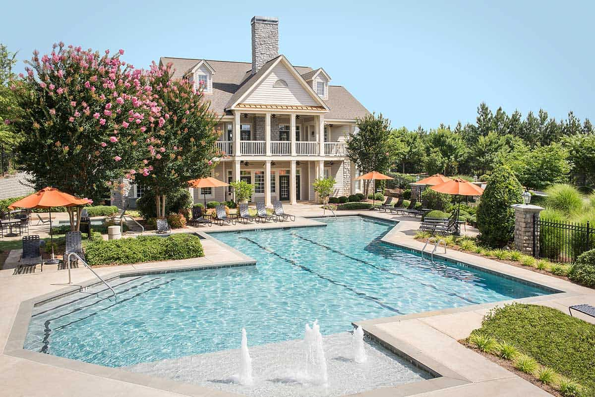 pool with view of club house at Greystone Properties Columbus GA apartments at Columbus ParkPark