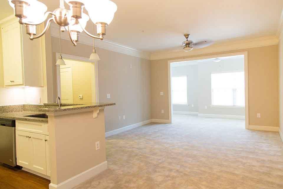 Greystone Summit at Forsyth Living Room view toward sunroom