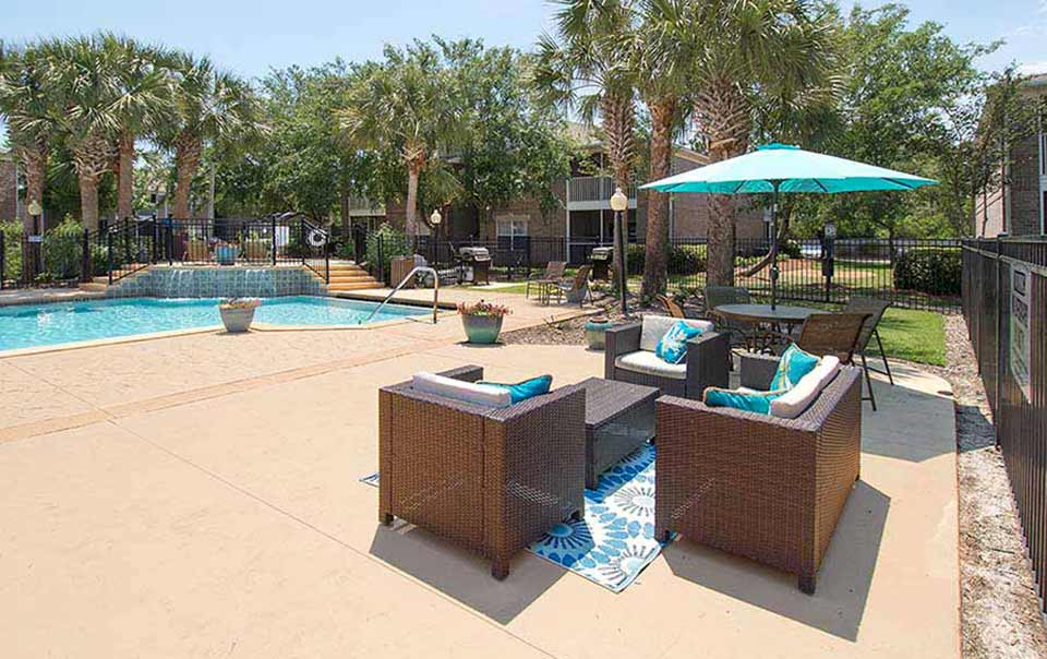 greystone properties gulf breeze reserve apartments sitting on pool deck