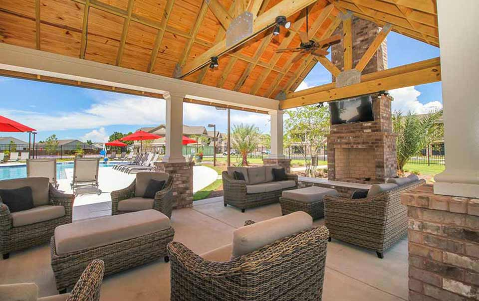 Outdoor fireplace at greystone properties gulf breeze reserve apartments