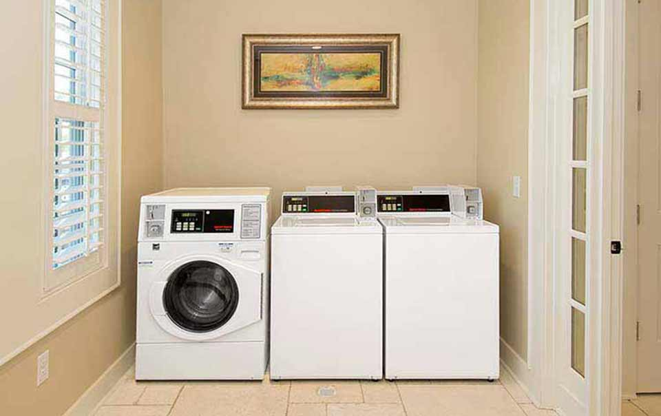 another vied of laundry room at greystone properties gulf breeze reserve apartments